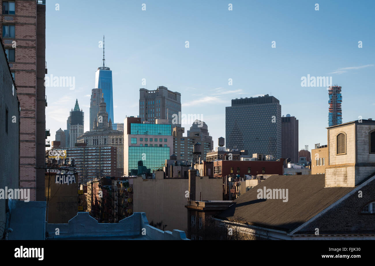 View across rooftops of Manhattan towards One World Trade Center and downtown. - Stock Image