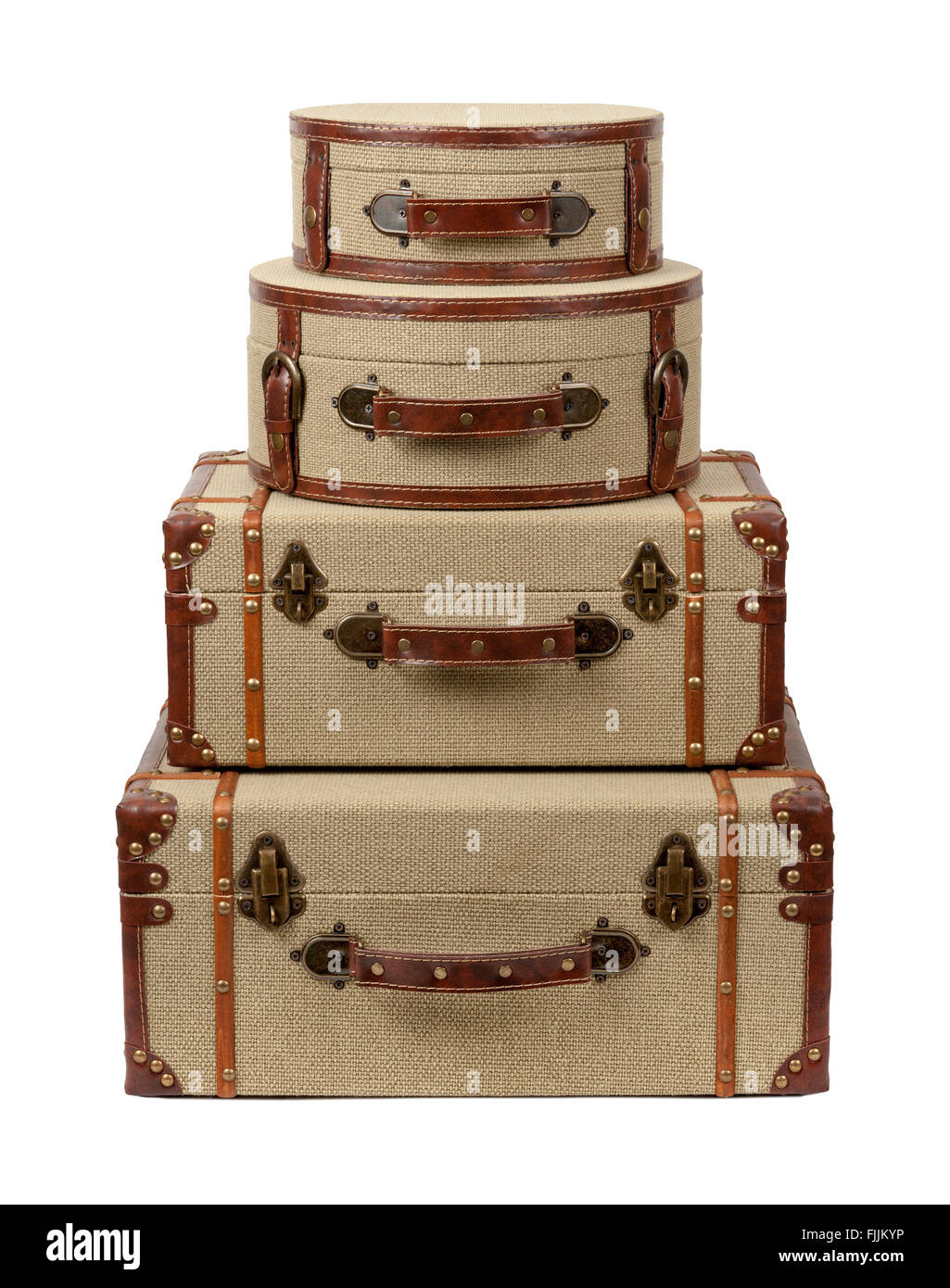 Four Stacked Deco Burlap Suitcases. The image is a cut out, isolated on a white background. - Stock Image