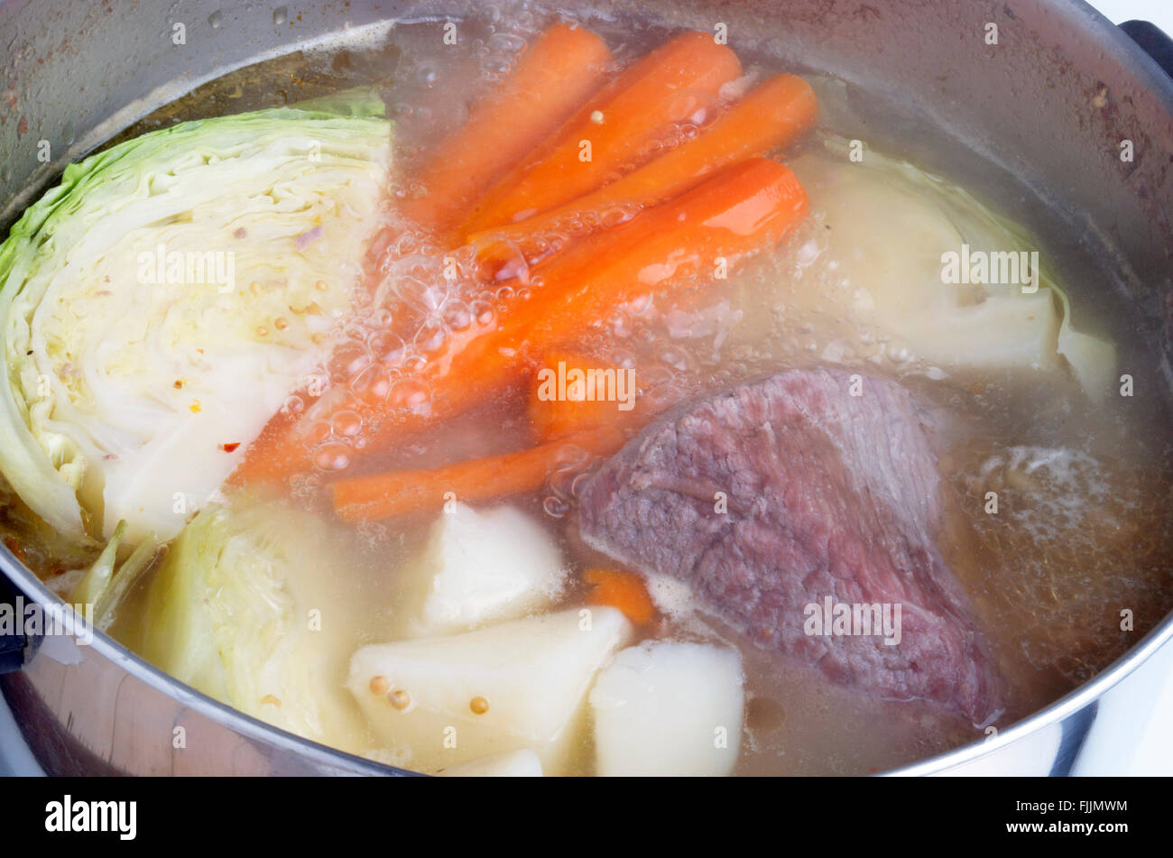 Boiling Corned Beef And Cabbage With Carrots and Potatoes - Stock Image