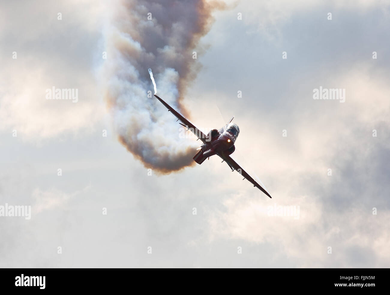 One of the RAFAT Red Arrows Synchro Pair runs in for an opposition pass - Stock Image