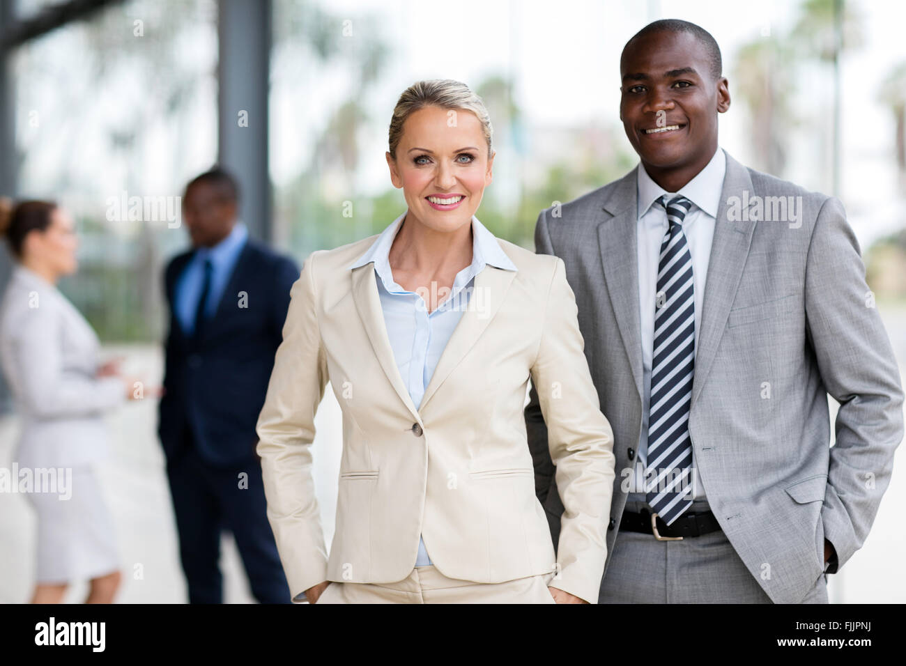 professional corporate co-workers looking at the camera - Stock Image