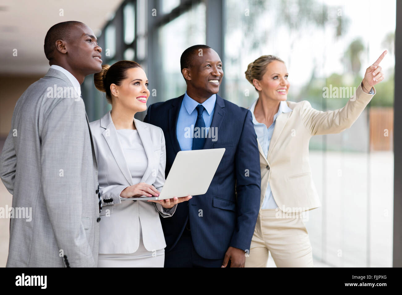 group of successful corporate workers discussing work in modern office - Stock Image