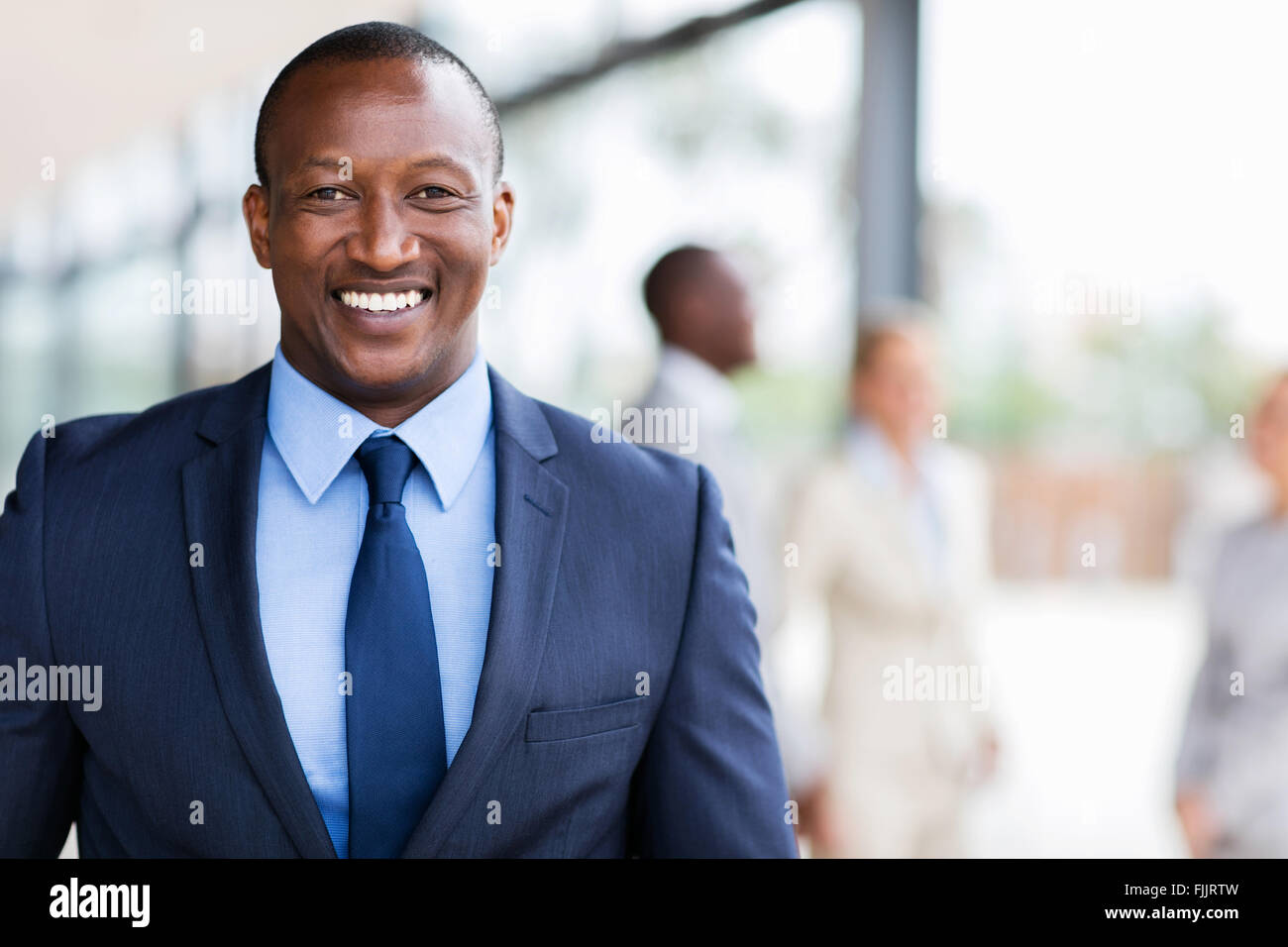smart African American business man in modern office - Stock Image