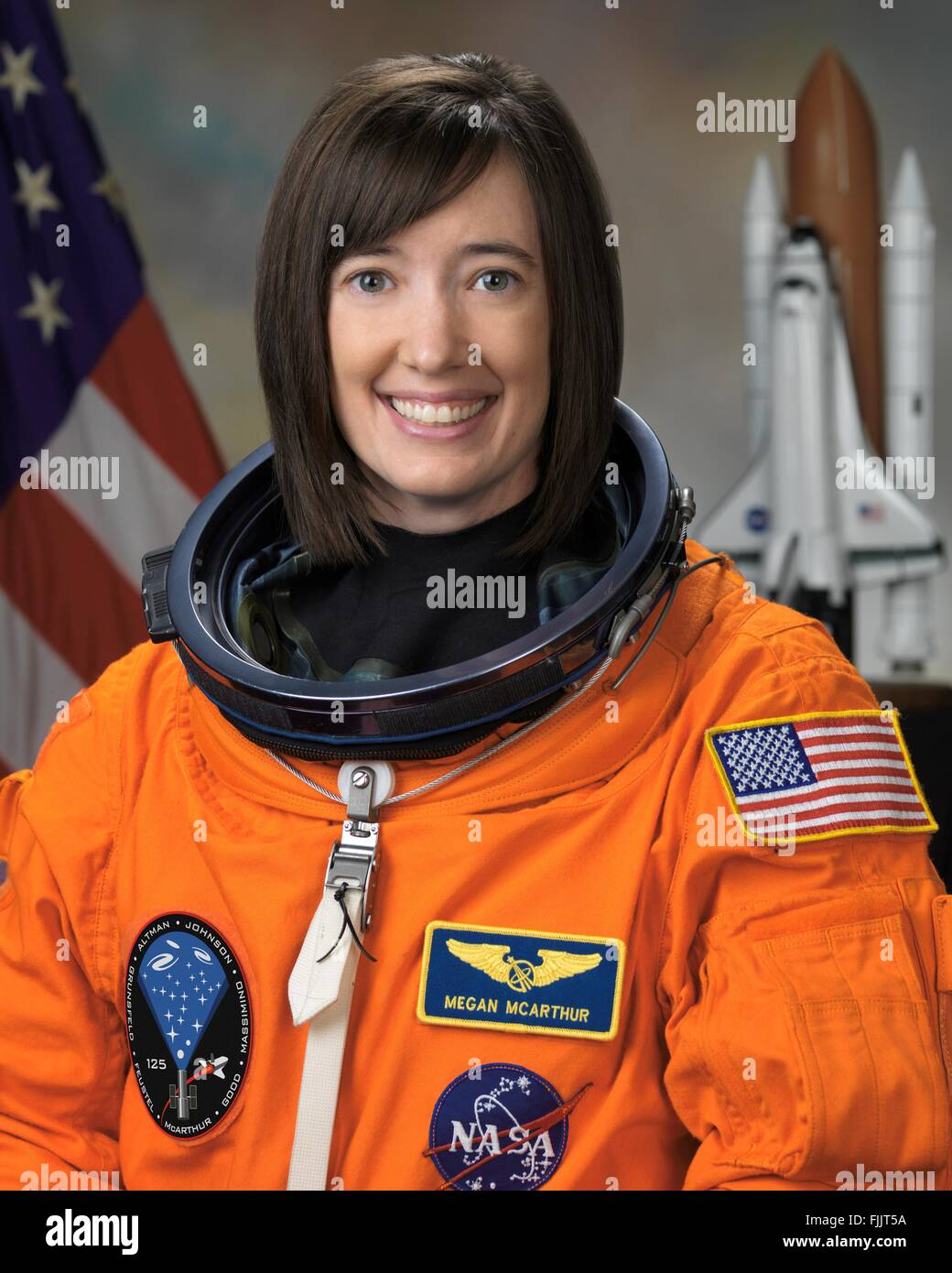NASA astronaut and shuttle mission STS-125 crew Megan McArthur official portrait wearing the orange space shuttle - Stock Image