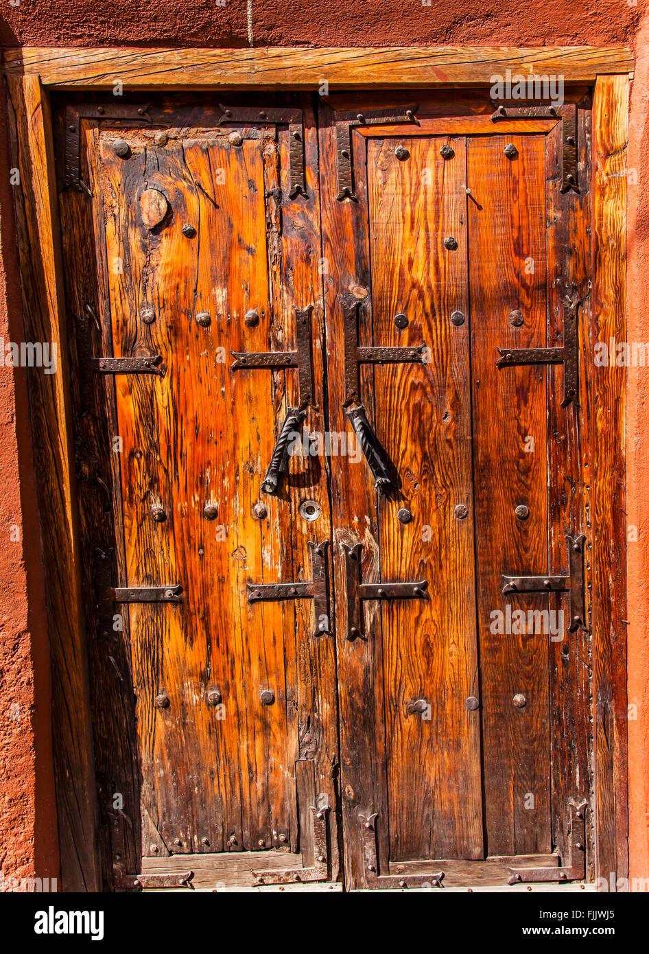 Golden Brown Wooden Door Jardin San Miguel de Allende Mexico - Stock Image