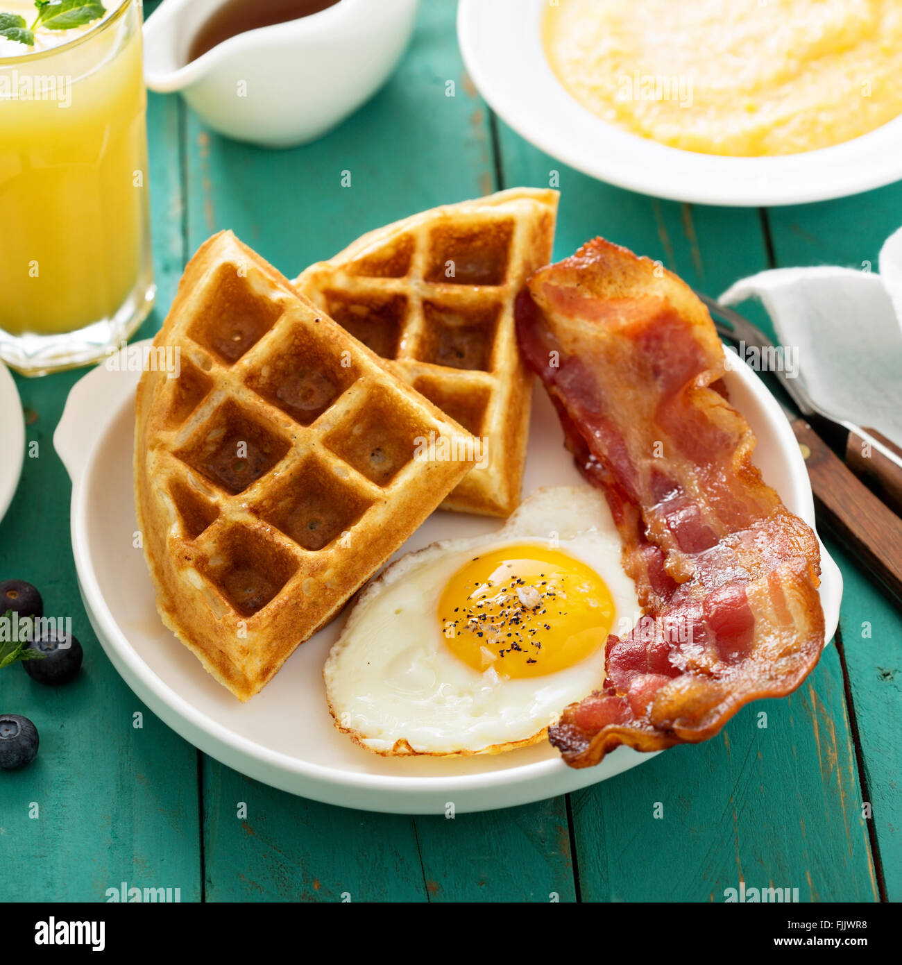 Southern cuisine breakfast with waffles - Stock Image