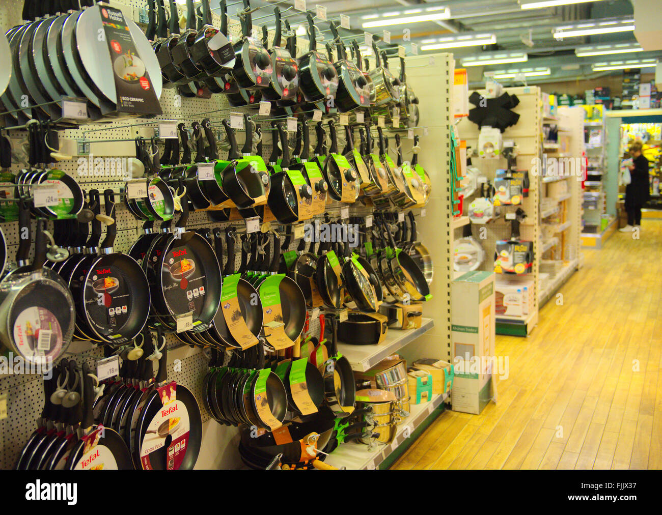 Pots and pans hanging on display for sale in shop - Stock Image
