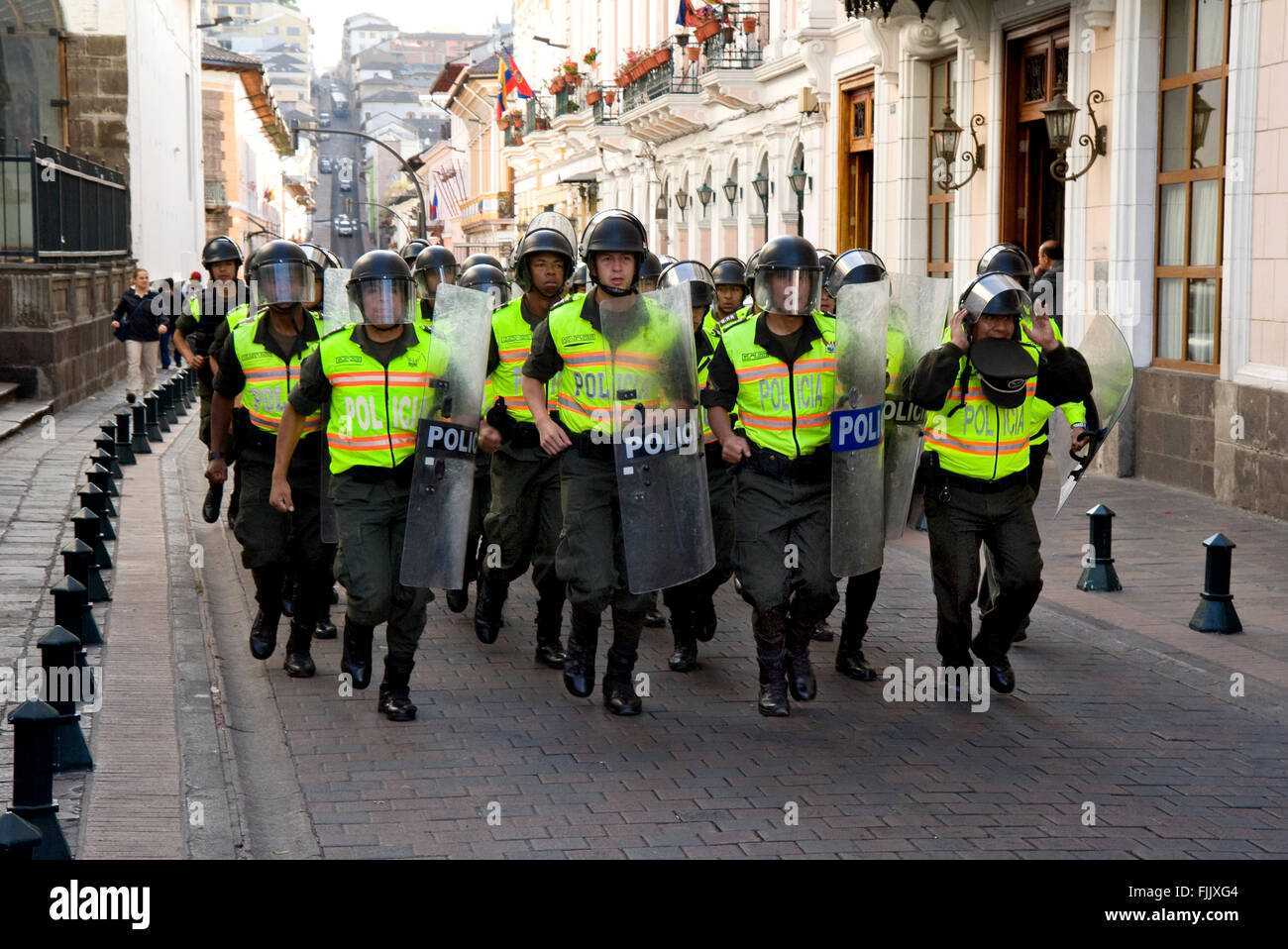 Riot police on charge in Quito, Ecuador - Stock Image