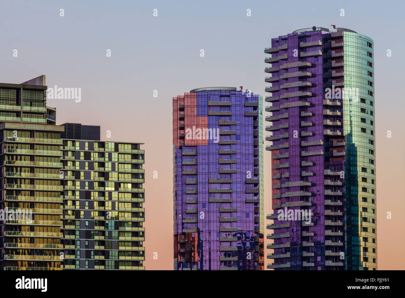 Closeup of residetial high rise buildings in Docklands, Melbourne at dawn - Stock Image