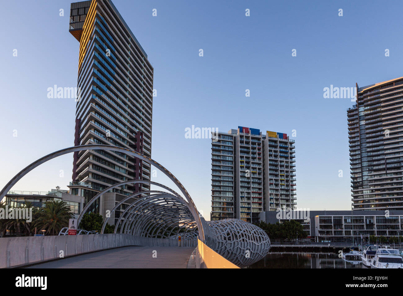 Webb Bridge and high rise buildings in Docklands, Melbourne - Stock Image