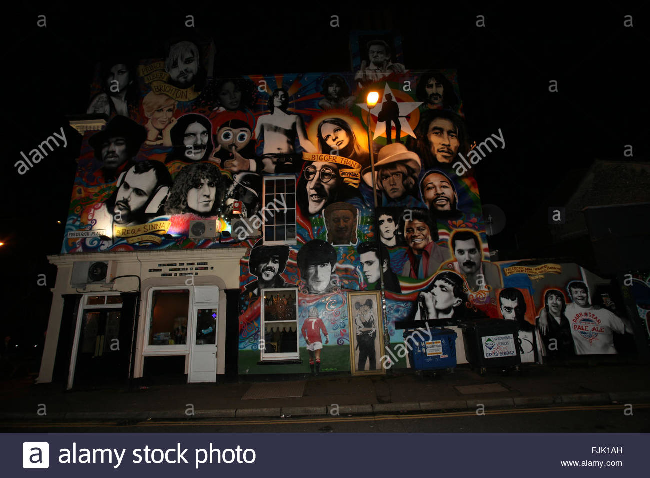 Looks like a Banksy graffiti, Kissing Coppers, but fake, rock n' roll mural on the wall of The Prince Albert, - Stock Image