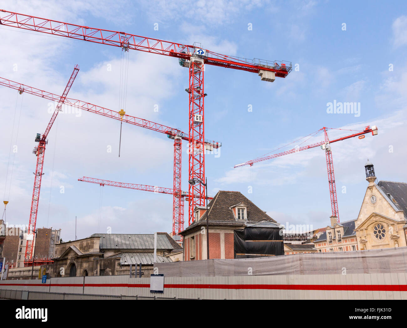 Construction cranes in Paris. A major redevelopment project for mixed residential and commercial space in a historic - Stock Image