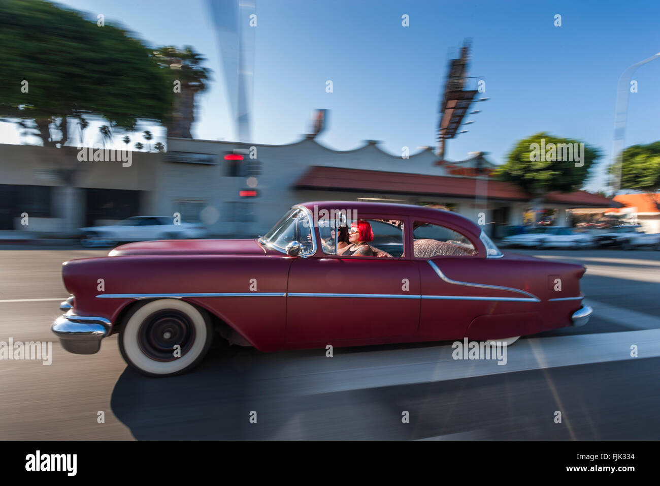 LOS ANGELES, CA – JUNE 29: Female latina's driving through Los Angeles, California on June 29, 2005. - Stock Image