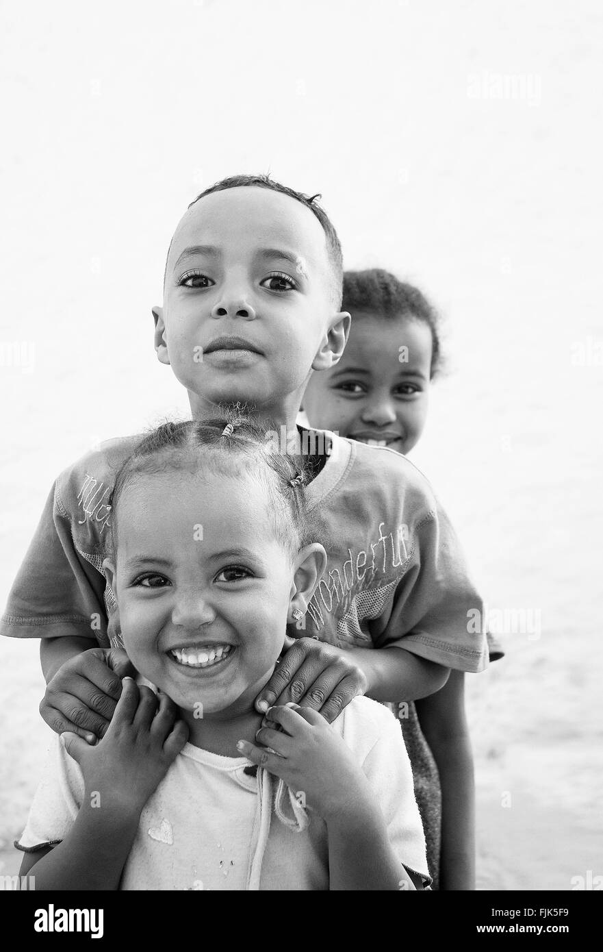happy smiling ethiopian african kids in harar ethiopia near somalia border - Stock Image