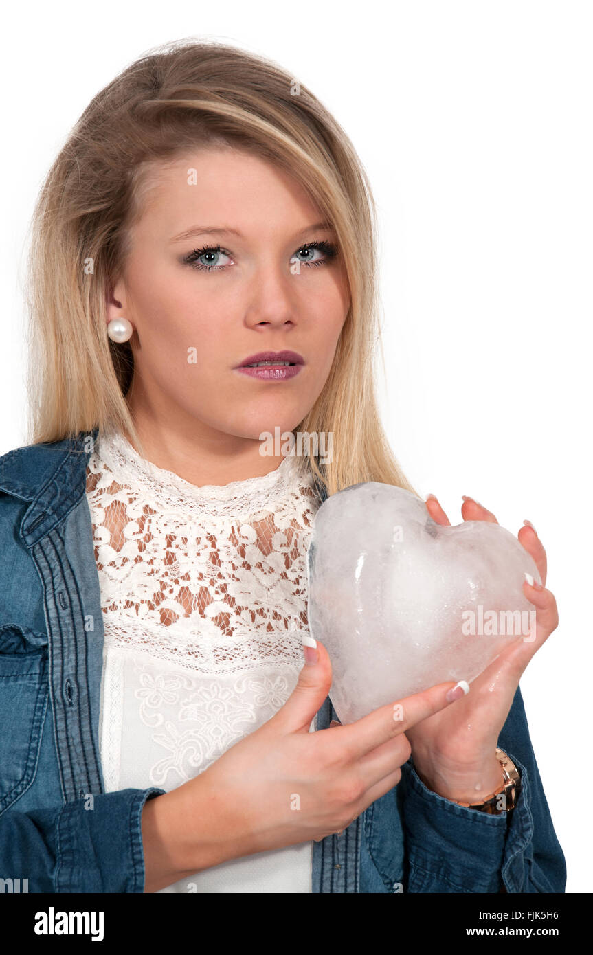 Woman holding a heart made of ice - Stock Image