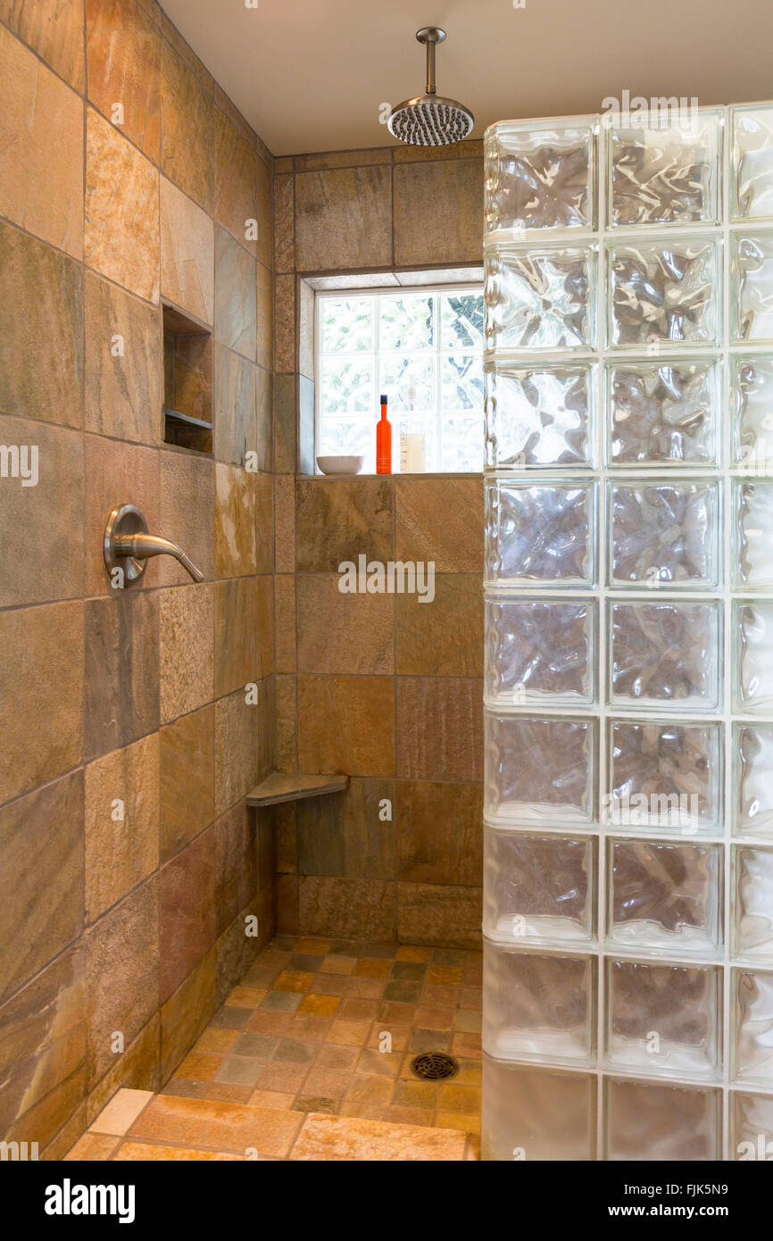 Spa bathroom shower area with slate tile and glass block walls in contemporary upscale home interior - Stock Image