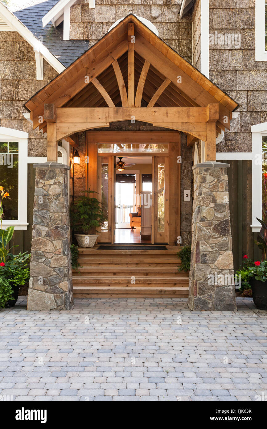 Craftsman Front Doors Craftsman Porch Facade House: Home Exterior With Wood And Stone Porch, Open Front Door And Paving Stock Photo: 97537543