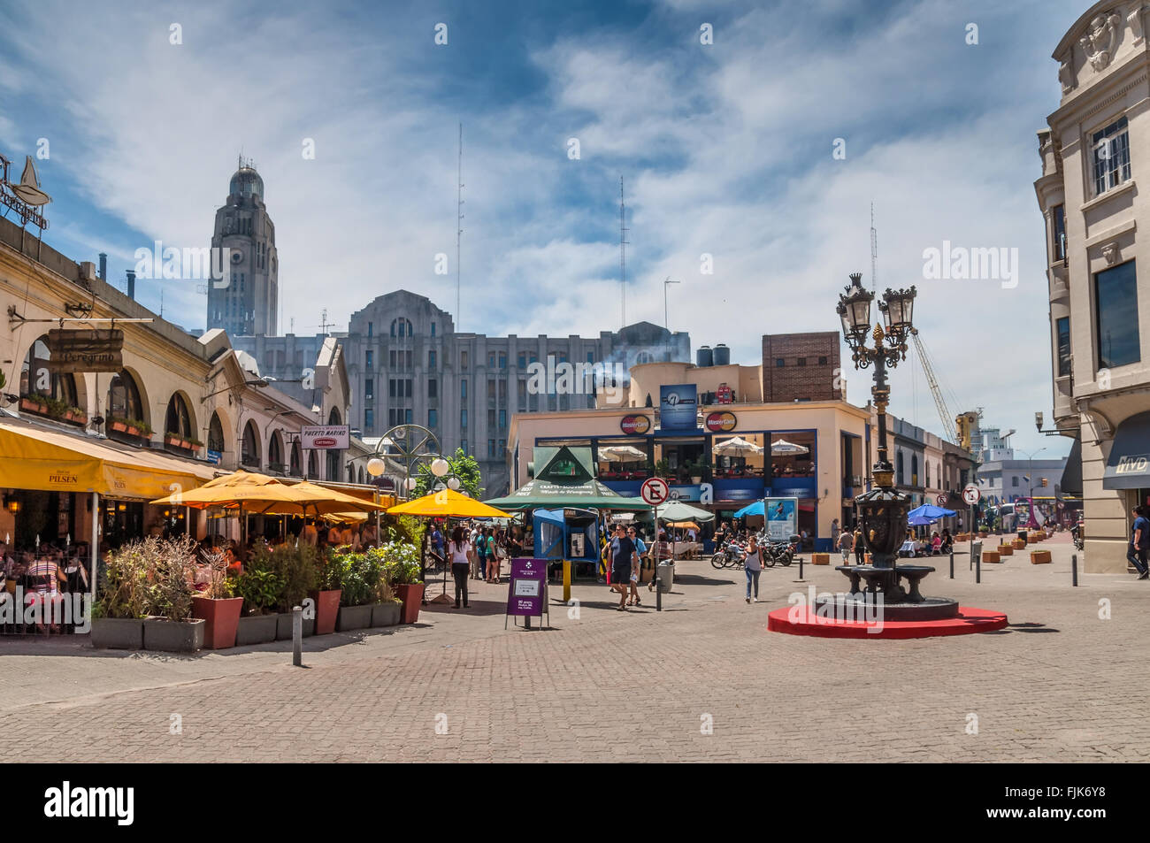 A view of Mercado del Puerto in the left, the famous place in Montevideo to eat local meat cuts - Stock Image
