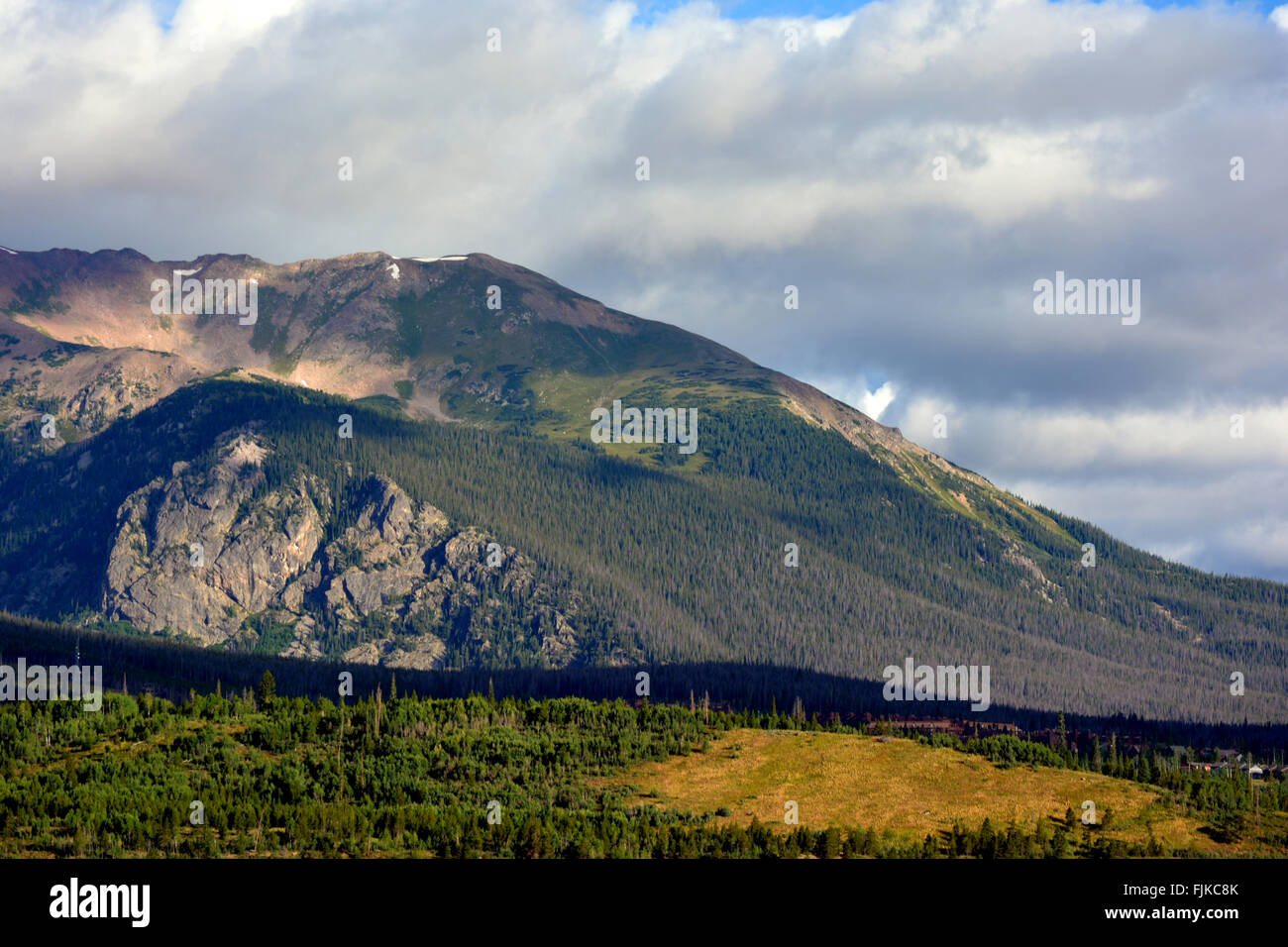 Rock Mountain at Dawn with Trees with Permafrost - Stock Image