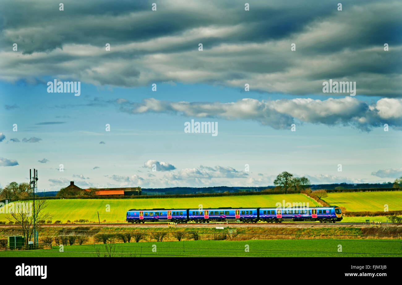 Transpennine Train on the Leeds Line at Colton Junction south of York - Stock Image