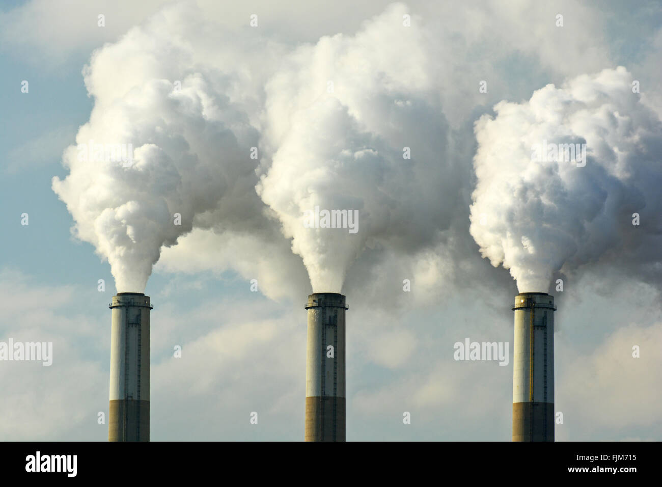Fossil Fuel Power Plant : Multiple coal fossil fuel power plant smokestacks emit