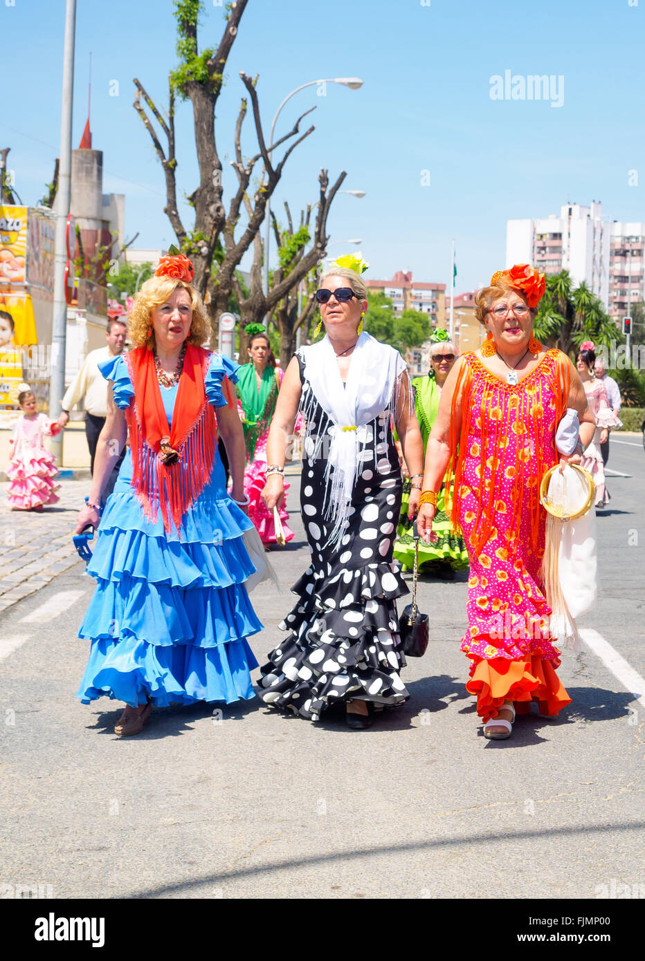 Seville, Spain - April 23, 2015: Women dressed in traditional costumes at the Seville's April Fair. - Stock Image