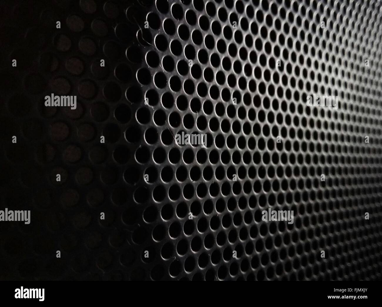 Full Frame Shot Of Perforated Metal - Stock Image