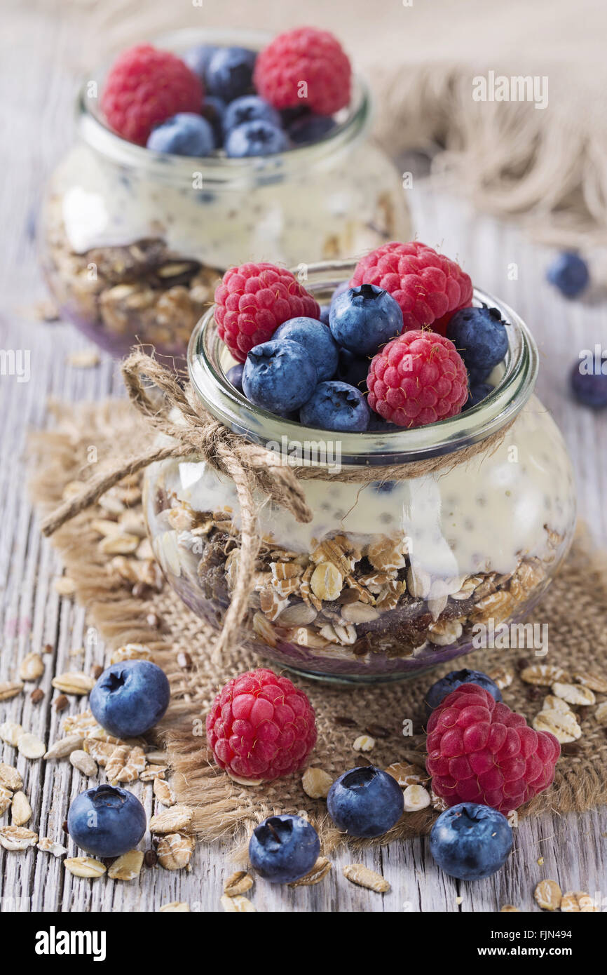 Chia seeds pudding with raspberries and blueberries - Stock Image