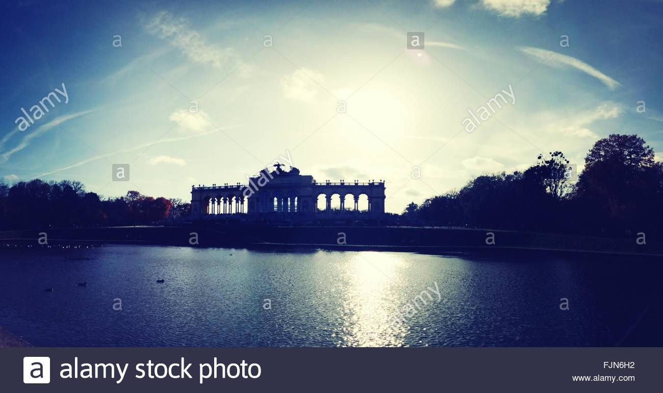Lake In Front Of Gloriette Against Sky At Dusk - Stock Image
