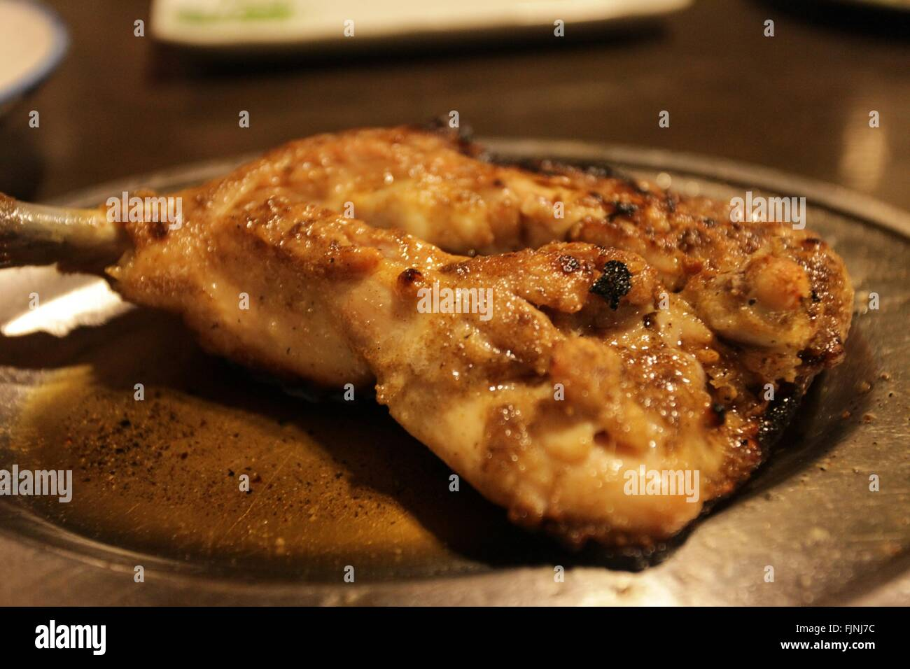 Close-Up Of Served Fried Chicken Meats In Plate - Stock Image