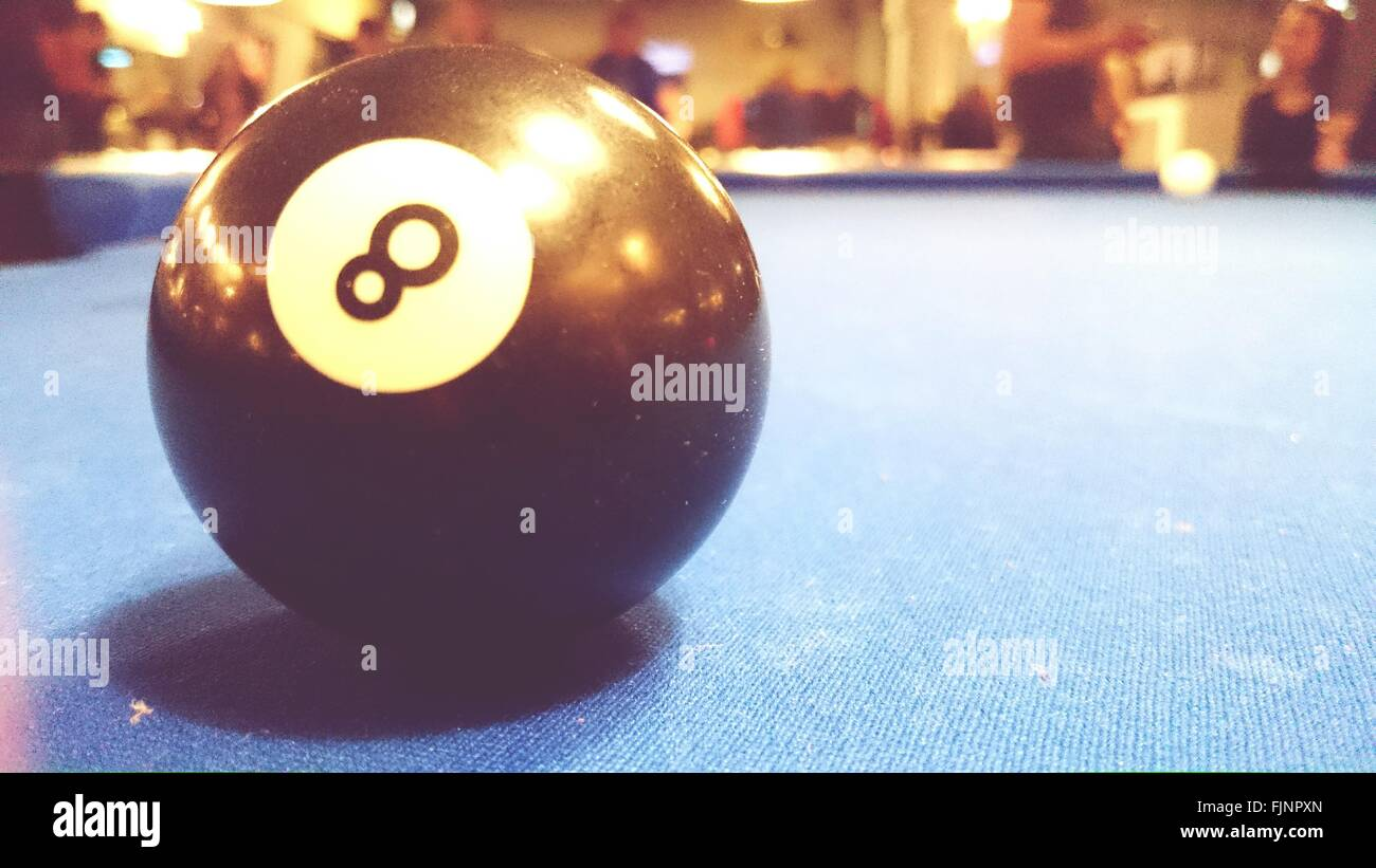Close-Up Of Pool Ball On Pool Table - Stock Image