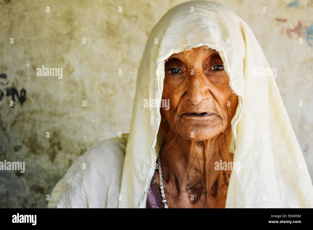 Close-Up Portrait Of Senior Woman - Stock Image