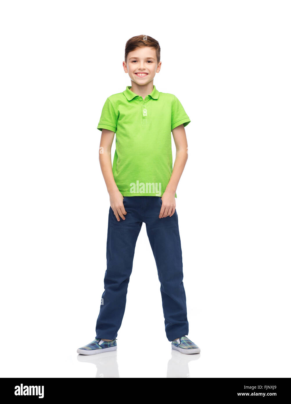 happy boy in green polo t-shirt - Stock Image