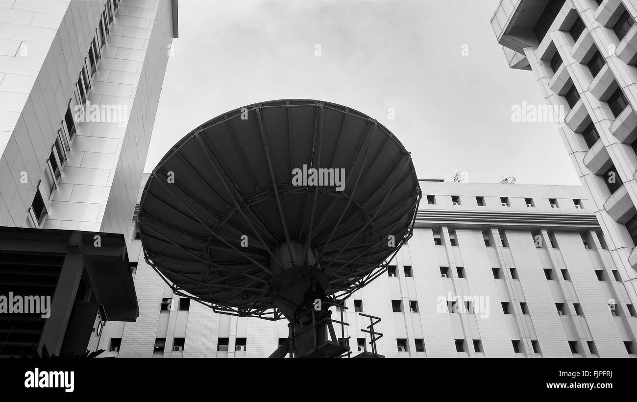 Low Angle View Of Satellite Dish With Modern Building - Stock Image