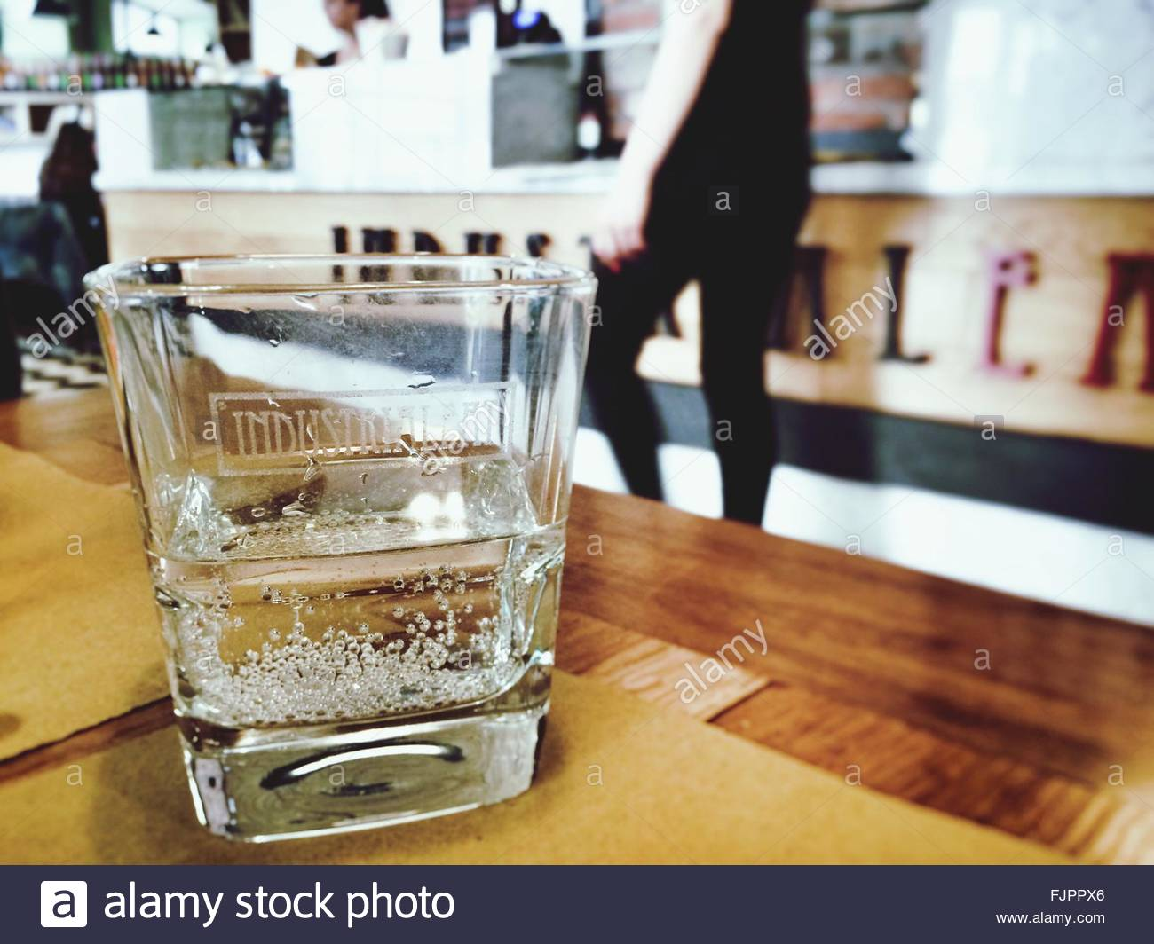 Close-Up Of Carbonated Water In Glass On Table - Stock Image