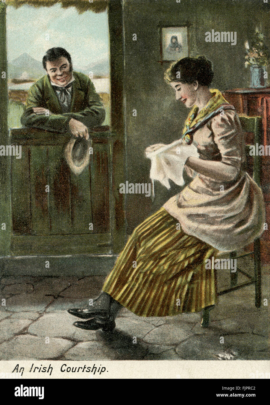 An Irish courtship - man talking to a woman in a cottage doing embroidery, postcard - Stock Image