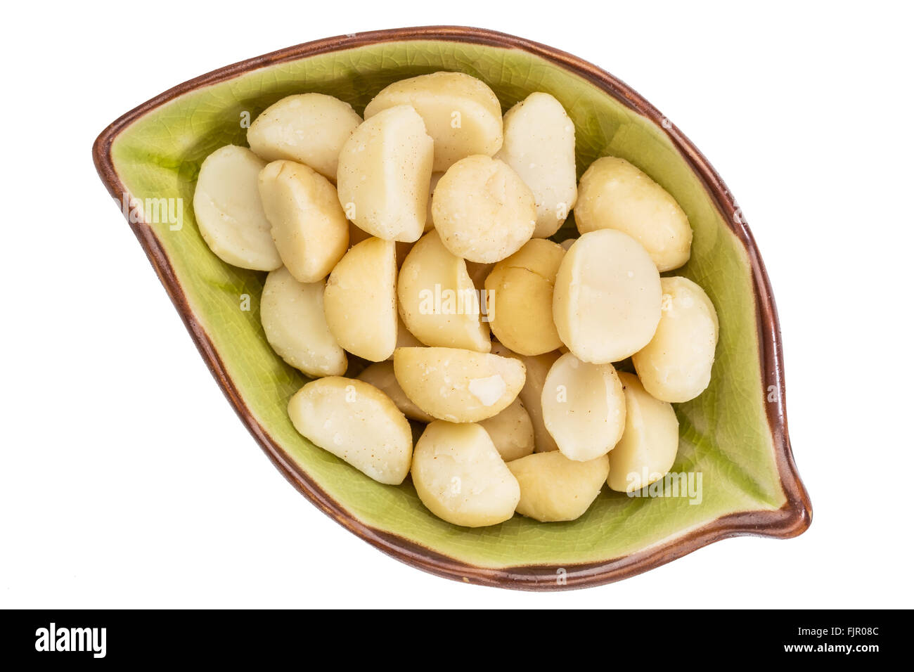 macadamia nuts  in an isolated leaf shaped ceramic bowl, top view Stock Photo