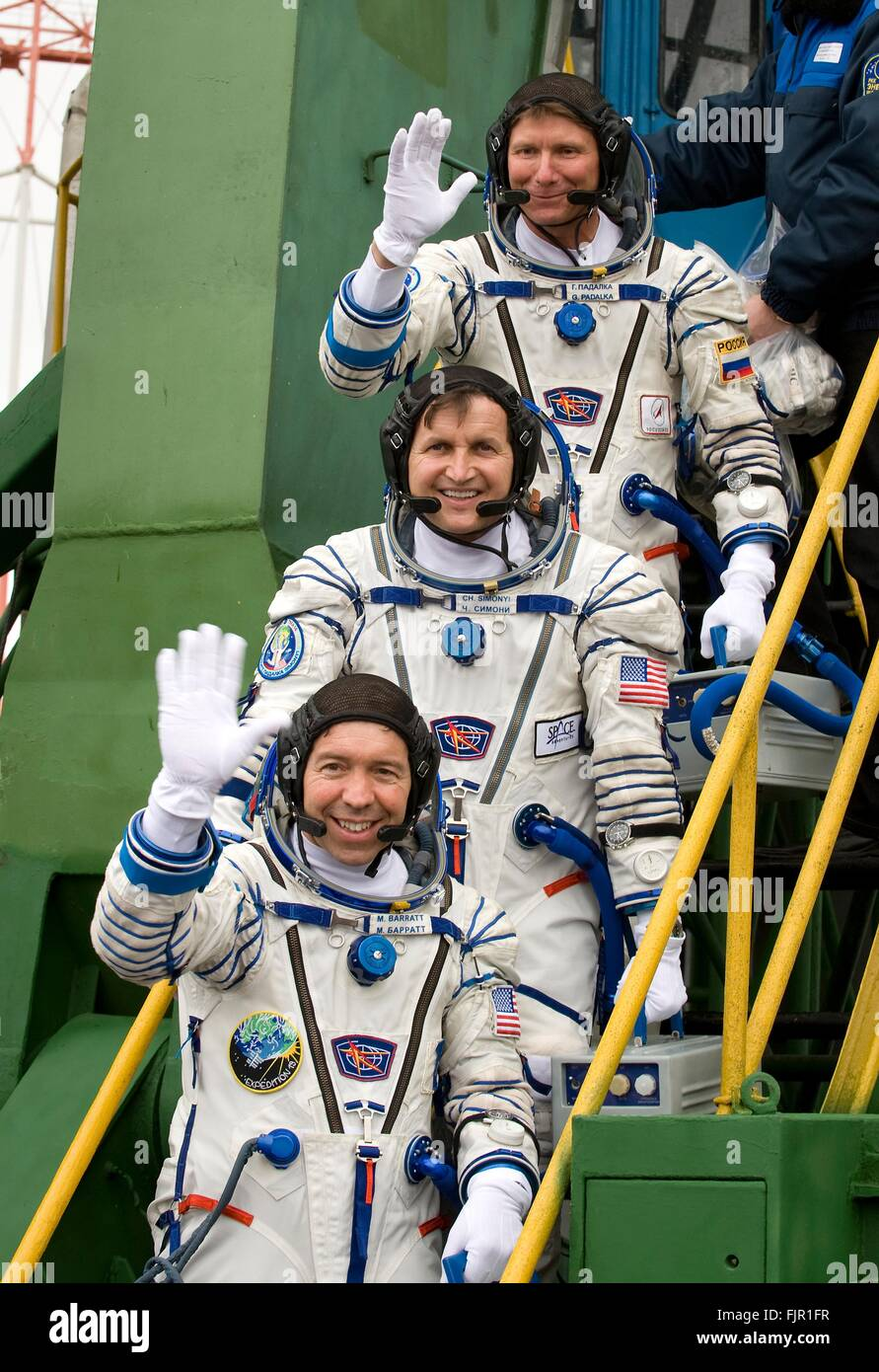 International Space Station Expedition 19 crew wave as they board the Soyuz TMA-10 spacecraft ahead of launch March - Stock Image