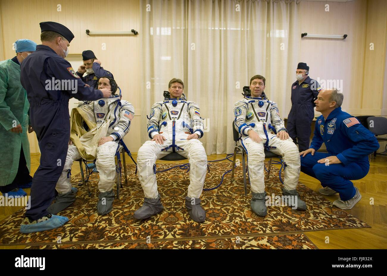 International Space Station Expedition 19 NASA crew members during the pressure check of their sokol spacesuits - Stock Image
