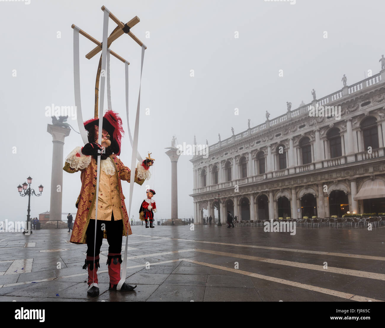 A man dressed up as puppeteer for the Carnival in Venice, Veneto, Italy - Stock Image