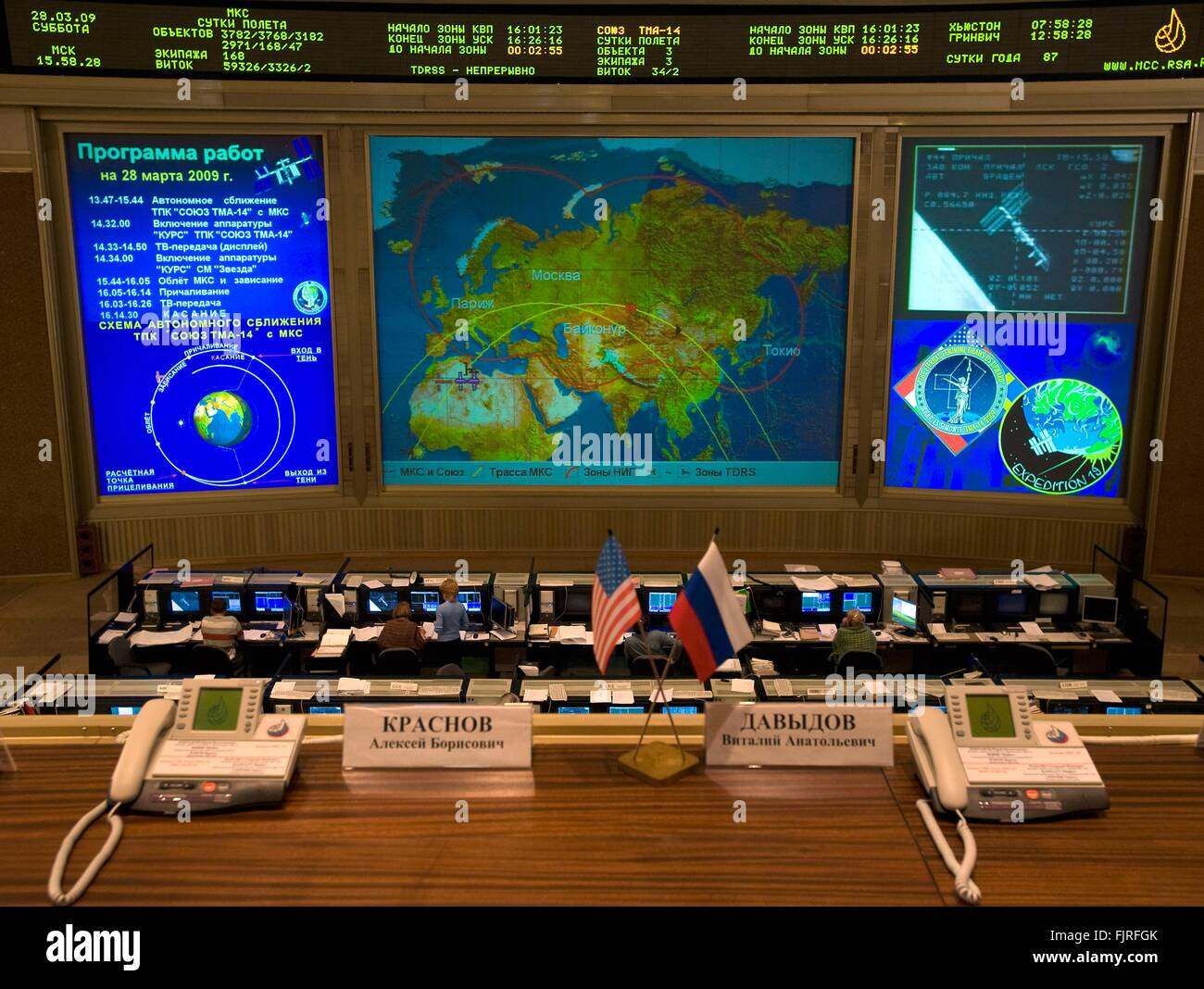 View of the Russian Mission Control center as the Soyuz TMA-14 spacecraft docks to the International Space Station - Stock Image