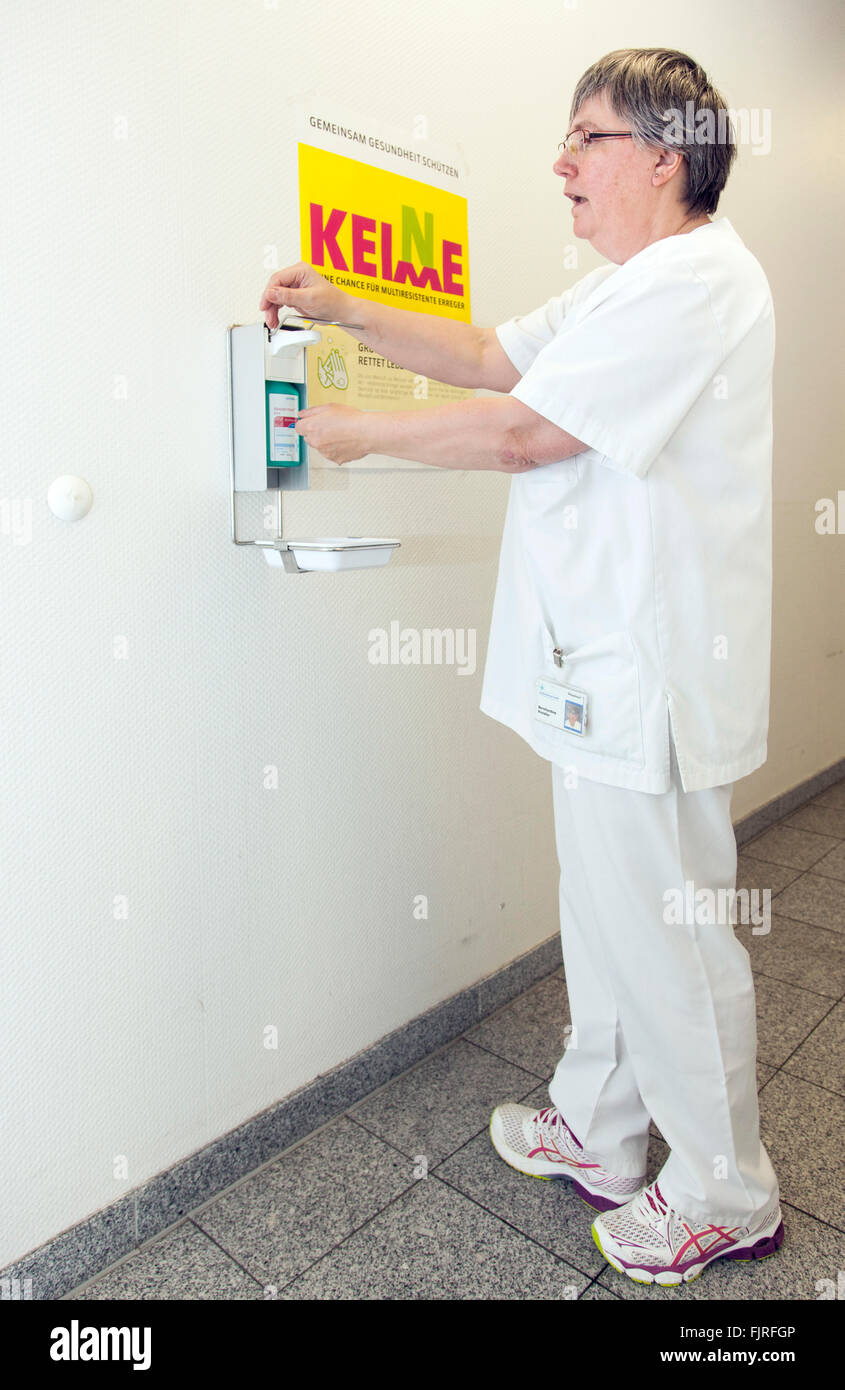 Campaign against multi-resistant pathogens. Nurse washes her hands. - Stock Image