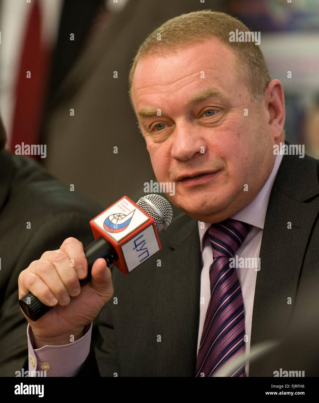 Vitaly Lopota, President and General Designer of RSC-Energia, answers questions from reporters following the sucessful - Stock Image