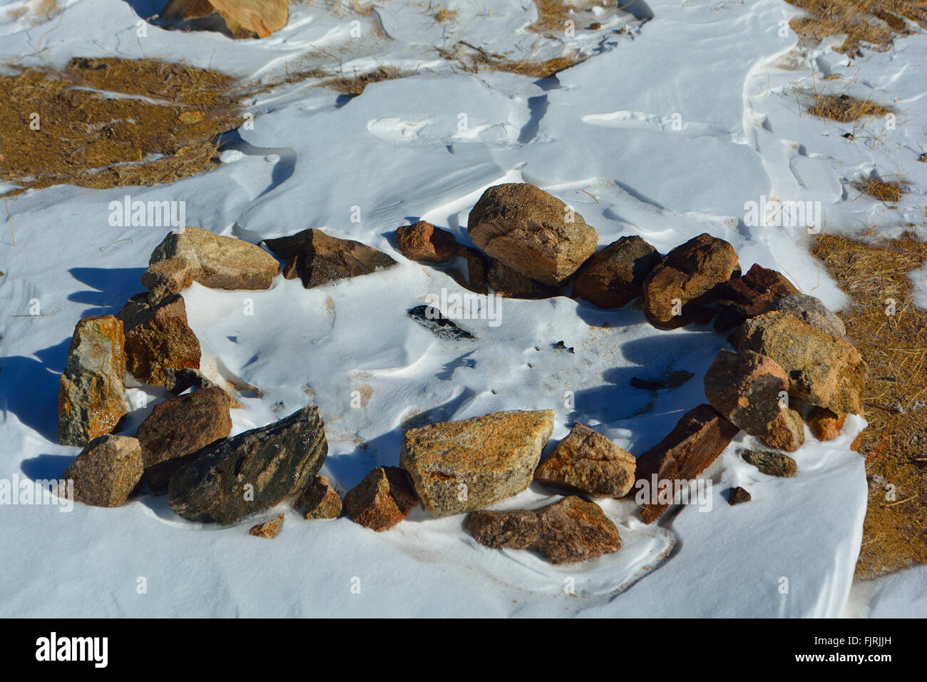 Snow Covered Camp Fire Rock Ring - Stock Image