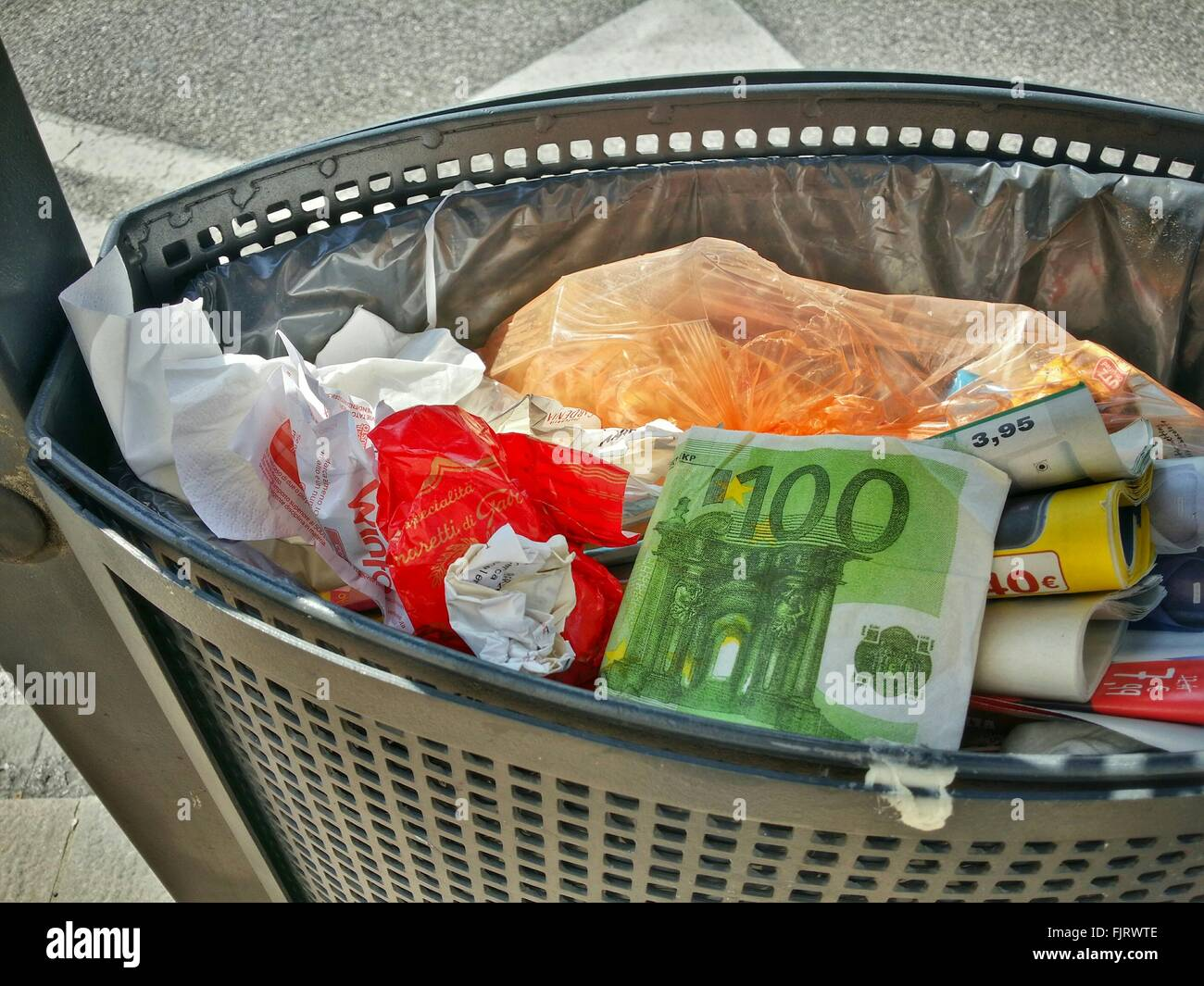 Artificial Currency In Wastepaper Basket - Stock Image