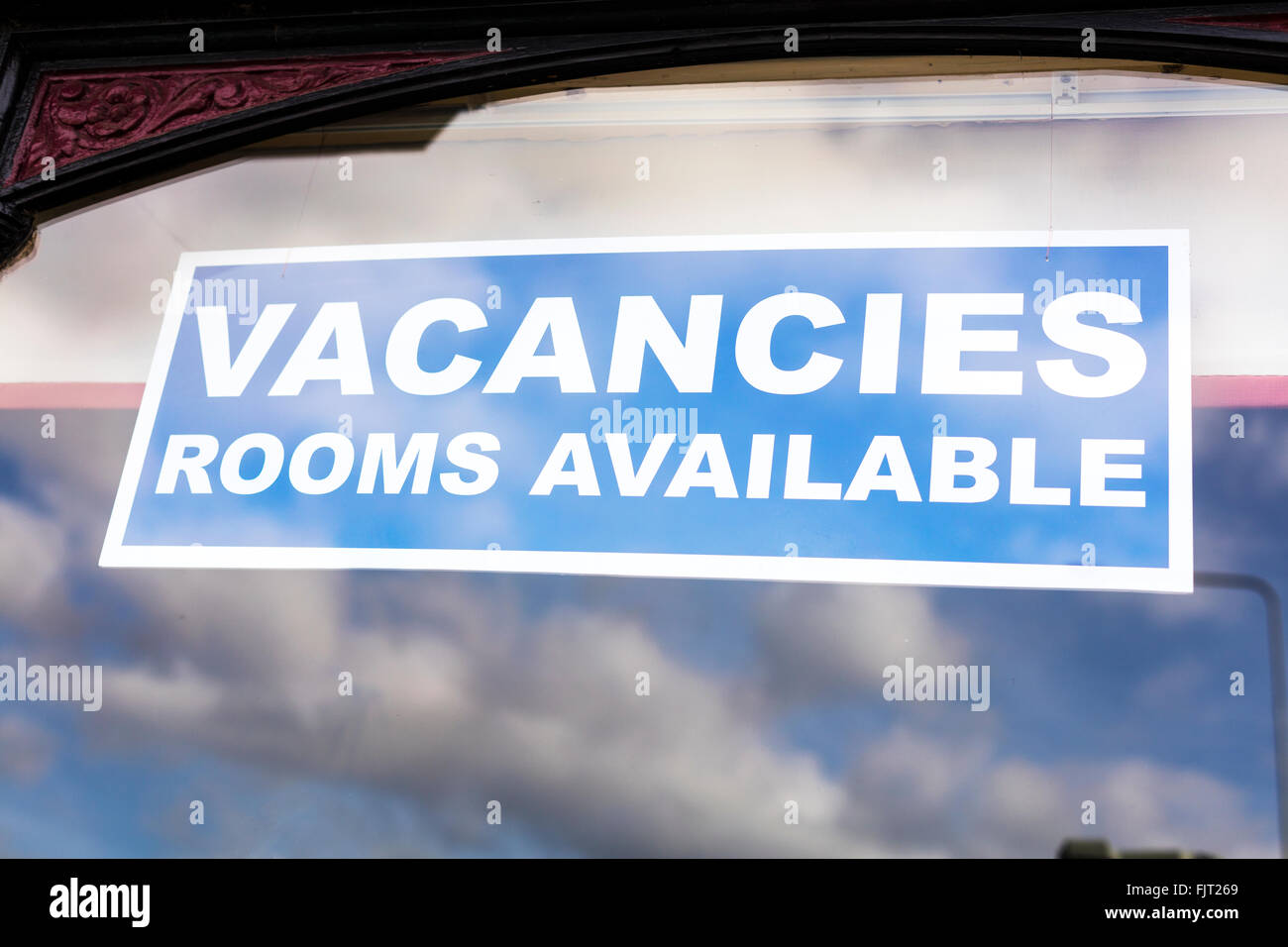 Vacancies rooms available sign hotel guest house room to rent stay lodge - Stock Image