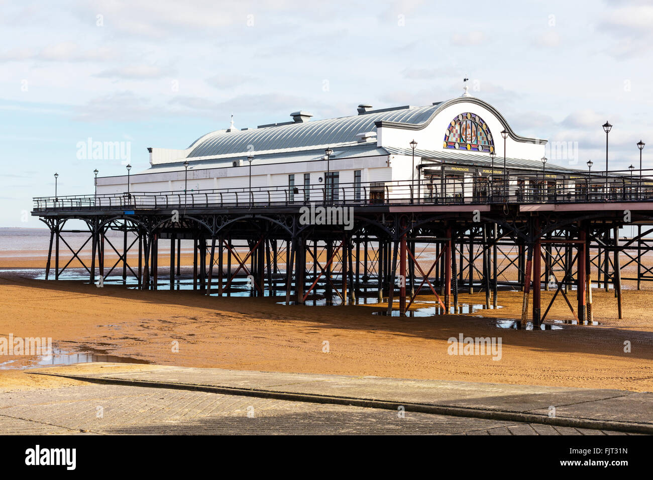 Cleethorpes pier UK England building exterior beach sand tide out - Stock Image