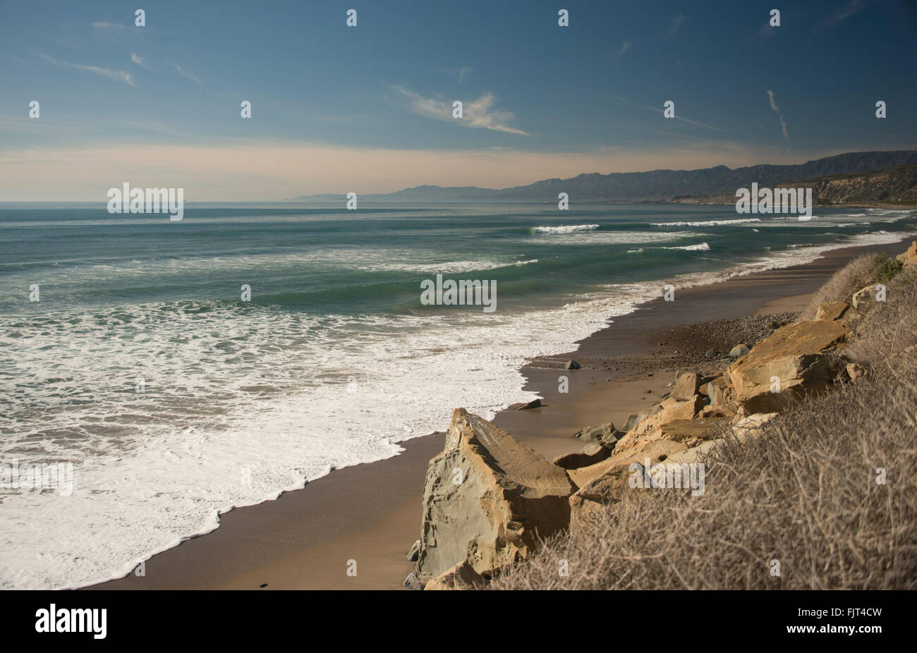 Pacific Ocean beach and coastline off PCH Route 1 near Malibu north of Los Angeles Southern California USA - Stock Image