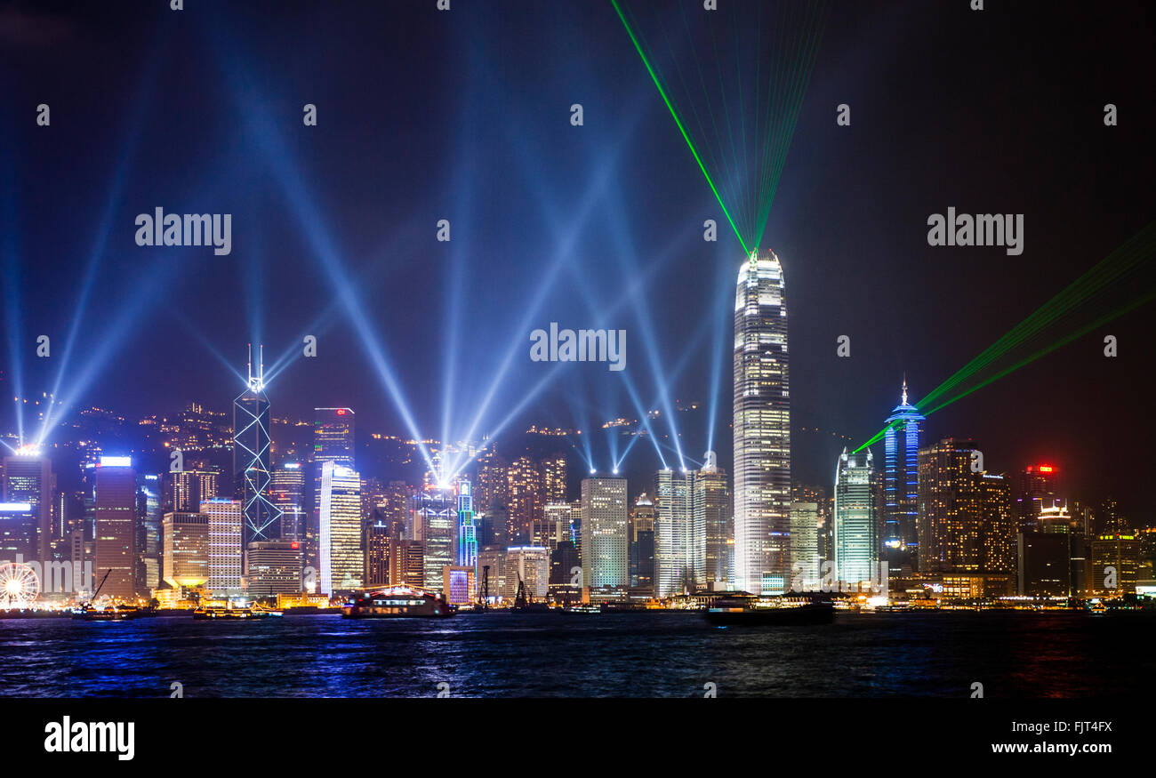 China, Hong Kong, view of Hong Kong Island and Central District across Victoria Harbour during the nightly laser - Stock Image