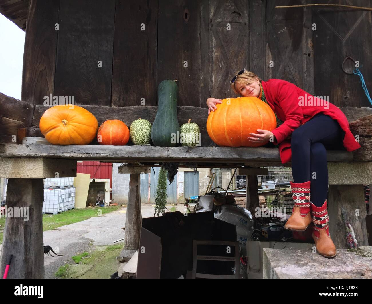 Person Sitting With Vegetables Stock Photo